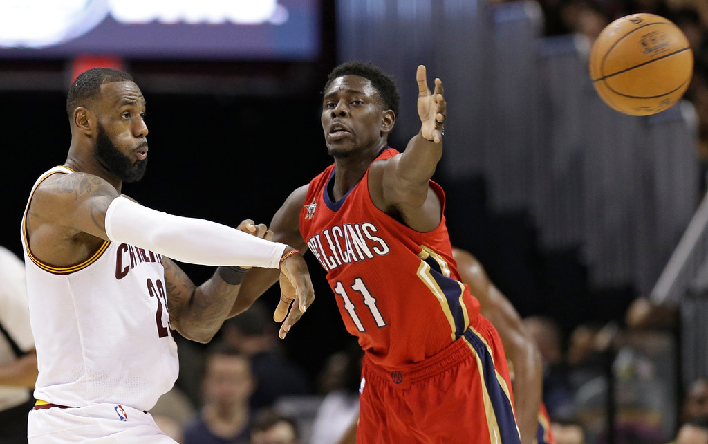 . Cleveland Cavaliers\' LeBron James, left, passes against New Orleans Pelicans\' Jrue Holiday in the second half of an NBA basketball game, Monday, Jan. 2, 2017, in Cleveland. The Cavaliers won 90-82. (AP Photo/Tony Dejak)