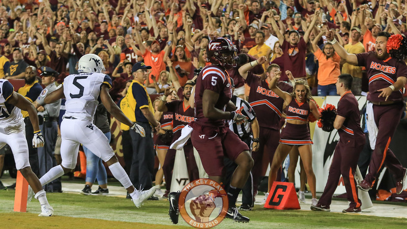Virginia Tech cheerleaders and fans celebrate as WR Cam Phillips runs untouched into the endzone in the third quarter. (Mark Umansky/TheKeyPlay.com)