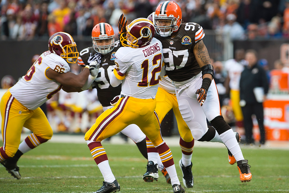 . Quarterback Kirk Cousins #12 of the Washington Redskins is sacked by defensive end Jabaal Sheard #97 of the Cleveland Browns during the first half at Cleveland Browns Stadium on December 16, 2012 in Cleveland, Ohio. (Photo by Jason Miller/Getty Images)
