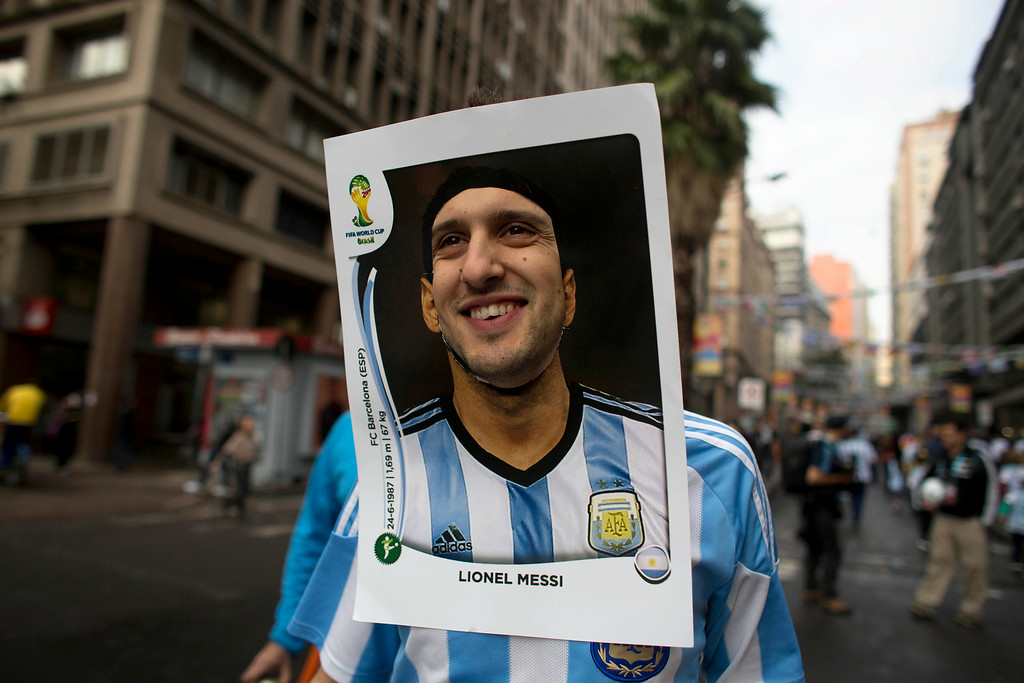 . An Argentina soccer fan wears a cutout image of Argentine soccer star Lionel Messi as he heads to the stadium to see the World Cup match between Argentina and Nigeria in Porto Alegre, Brazil, Wednesday, June 25, 2014.  (AP Photo/Dario Lopez-Mills)