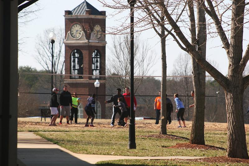 Gardner-Webb University students playing volleyball.