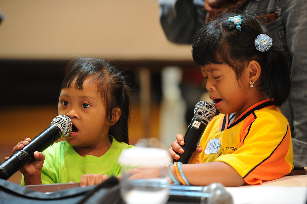 . Indonesian children with Down syndrome sing together as they celebrate World Down Syndrome Day on March 21, 2014 in Surabaya, Indonesia. Today marks the 9th anniversary of World Down Syndrome and focuses on supporting all people with Down syndrome on their right to access healthcare without discrimination and with proper assessment of the specific health needs of the individual.  (Photo by Robertus Pudyanto/Getty Images)