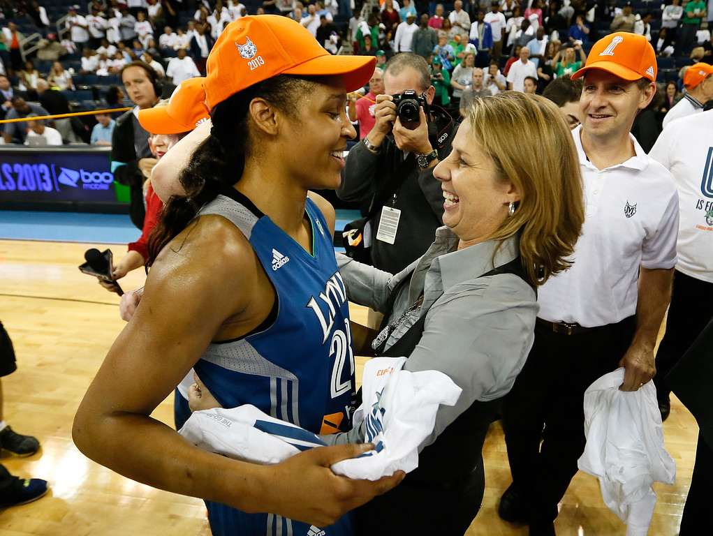 . ATLANTA, GA - OCTOBER 10:  Head coach Cheryl Reeve of the Minnesota Lynx hugs Maya Moore #23 after their 86-77 win over the Atlanta Dream in Game Three of the 2013 WNBA Finals at Philips Arena on October 10, 2013 in Atlanta, Georgia.   (Photo by Kevin C. Cox/Getty Images)