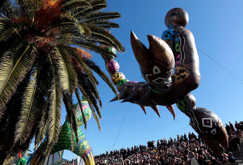 ". A balloon in the shape of a scorpion is paraded during the Carnival parade in Nice February 16, 2013. The 129th Carnival of Nice runs from February 15 to March 6 and celebrates the ""King of the Five Continents\"".      REUTERS/Eric Gaillard"