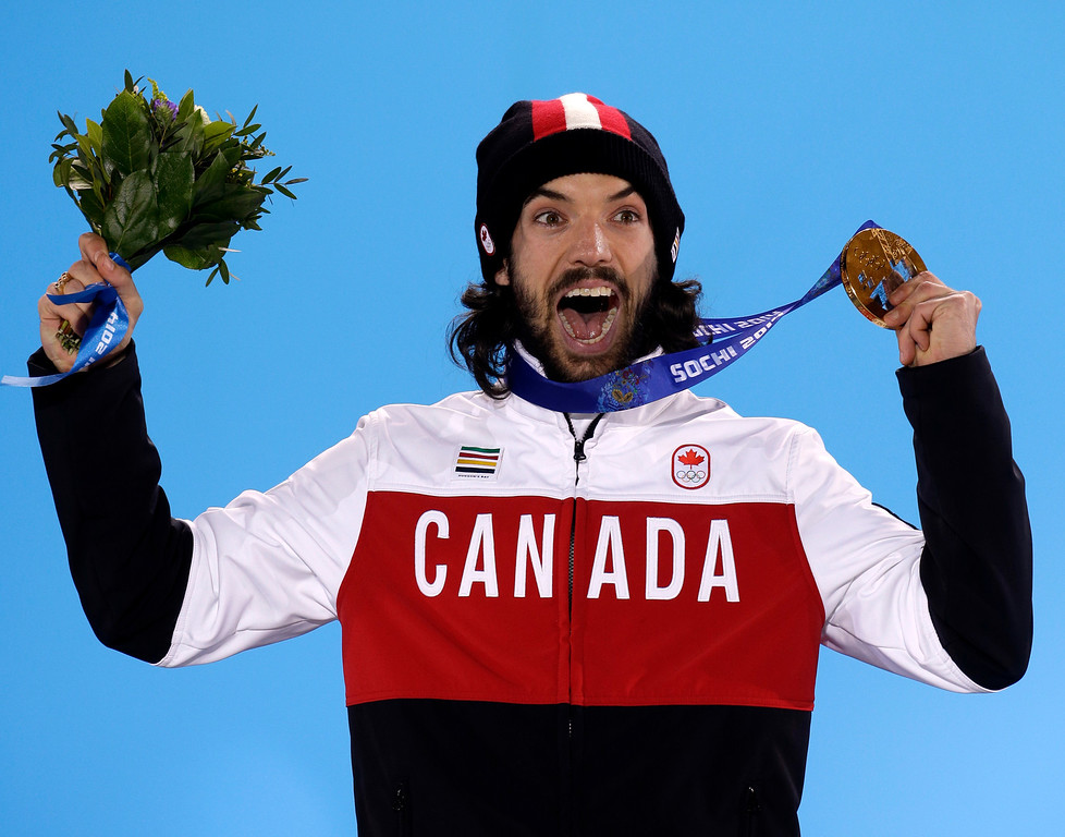 . Charles Hamelin of Canada, who won the gold medal in men\'s 1,500-meter short track speedskating celebrates during the medals ceremony at the 2014 Winter Olympics, Monday, Feb. 10, 2014, in Sochi, Russia.  (AP Photo/Morry Gash)