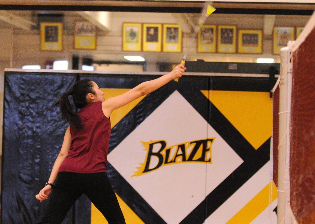. Johnson senior Ka Lia Her returns a volley against her opponen.   (Pioneer Press: John Autey)