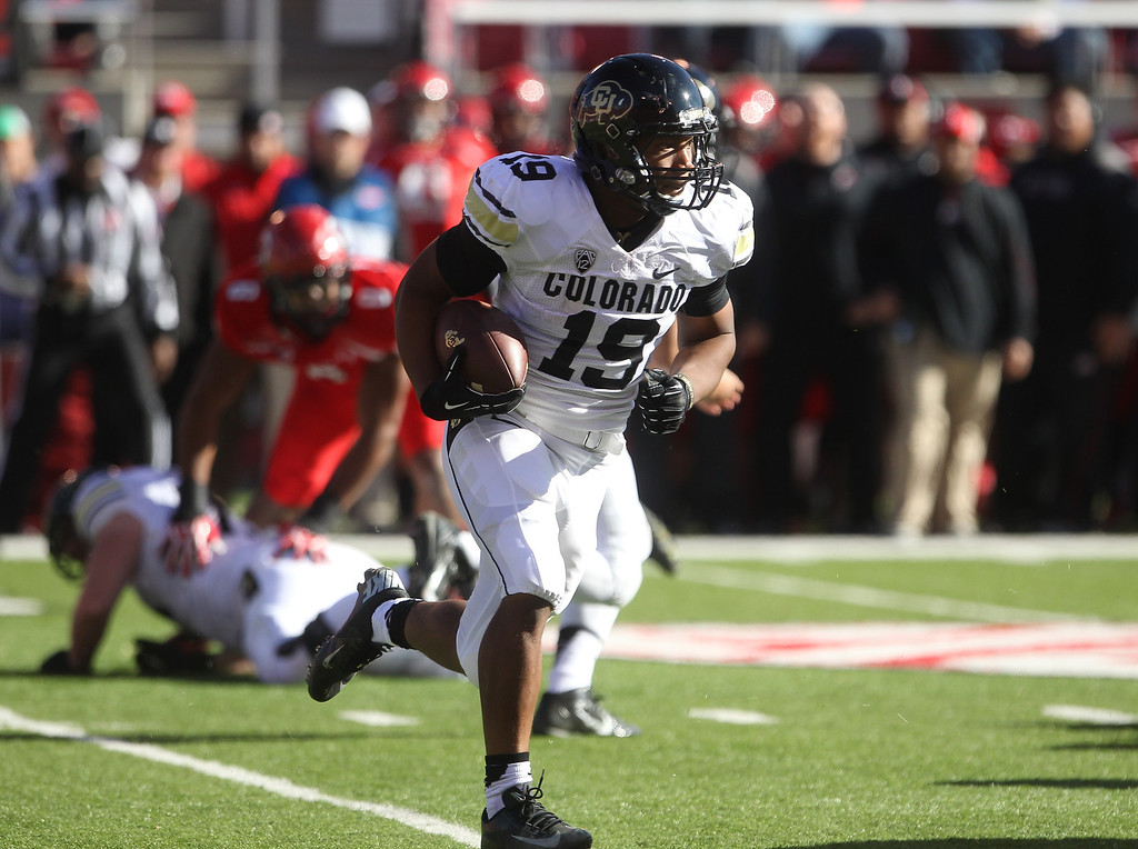 . Colorado running back Michael Adkins II (19) carries the ball in the first half during an NCAA college football game against Utah, Saturday, Nov. 30, 2013, in Salt Lake City. (AP Photo/Rick Bowmer)