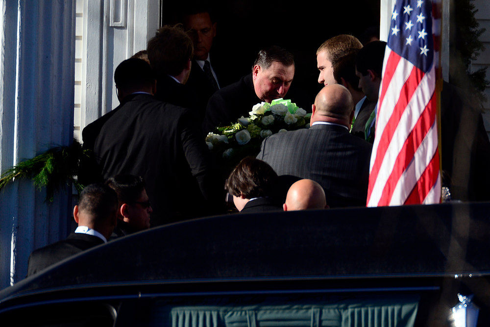 Description of . Pallbearers carry the casket during the funeral service for Victoria Soto, 27, in Stratford, Connecticut on Wednesday, December 19, 2012. Soto, a first grade teacher, was shot and killed during the Newton shooting as she attempted to protect her students against the gunman. AAron Ontiveroz, The Denver Post