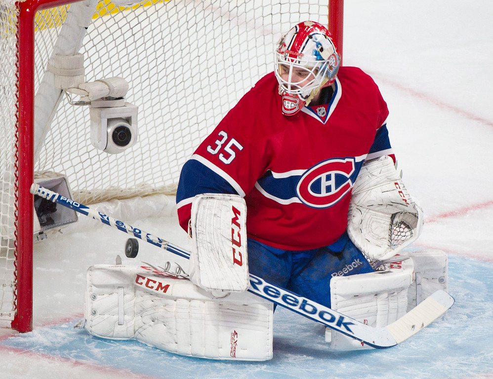 . Montreal Canadiens goaltender Dustin Tokarski is scored on by New York Rangers\' Ryan McDonagh during the first period in Game 2 of the NHL hockey Eastern Conference final Stanley Cup playoff game in Montreal, Monday, May 19, 2014. (AP Photo/The Canadian Press, Graham Hughes)
