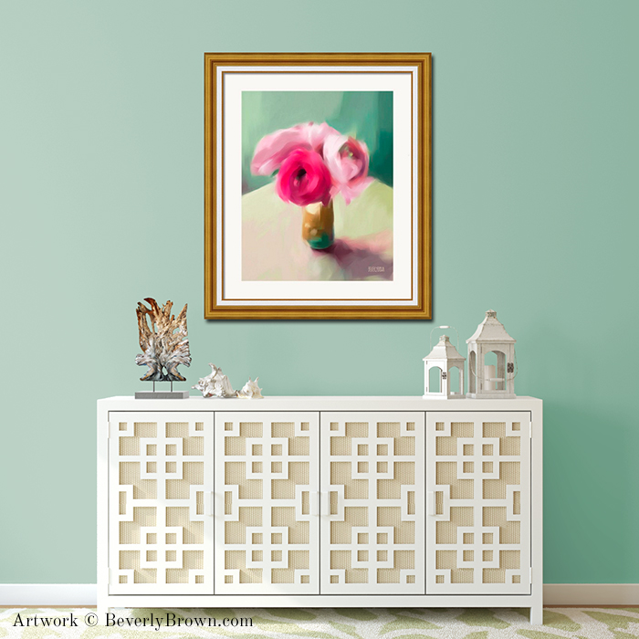 Pink, teal, aqua blue and yellow ranunculus large framed floral wall art painting print by Beverly Brown. Displayed in over a sideboard in a cottage style room with aqua walls. Available on canvas, metal, acrylic & fine paper in multiple sizes.