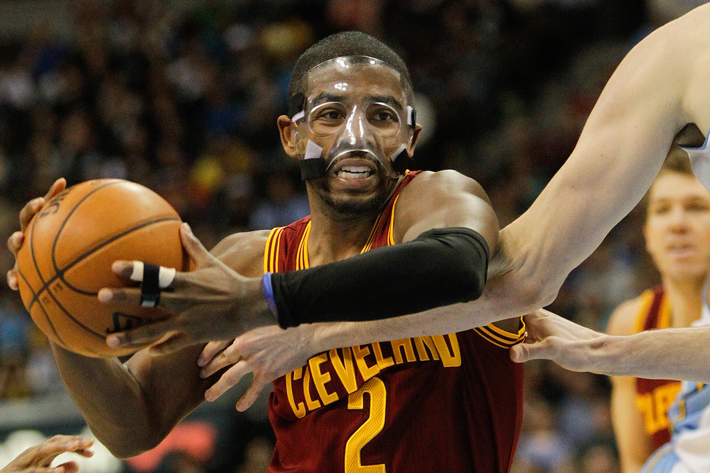 . Cleveland Cavaliers\' Kyrie Irving drive to the basket during the third quarter of an NBA basketball game against the Denver Nuggets Friday, Jan. 11, 2013, in Denver. The Nuggets won 98-91 (AP Photo/Barry Gutierrez)