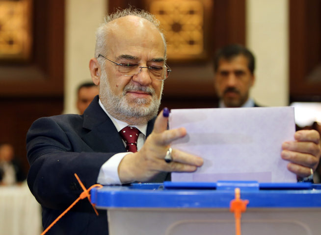Description of . Former Iraqi prime minster Ibrihim al-Jaafari shows his ink-stained finger as he casts his vote in Iraq's first parliamentary election since US troops withdrew at a polling station in Baghdad's fortified Green Zone, on April 30, 2014. Iraqis streamed to voting centres nationwide, amid the worst bloodshed in years, as Prime Minister Nuri al-Maliki seeks reelection. (ALI AL-SAADI/AFP/Getty Images)