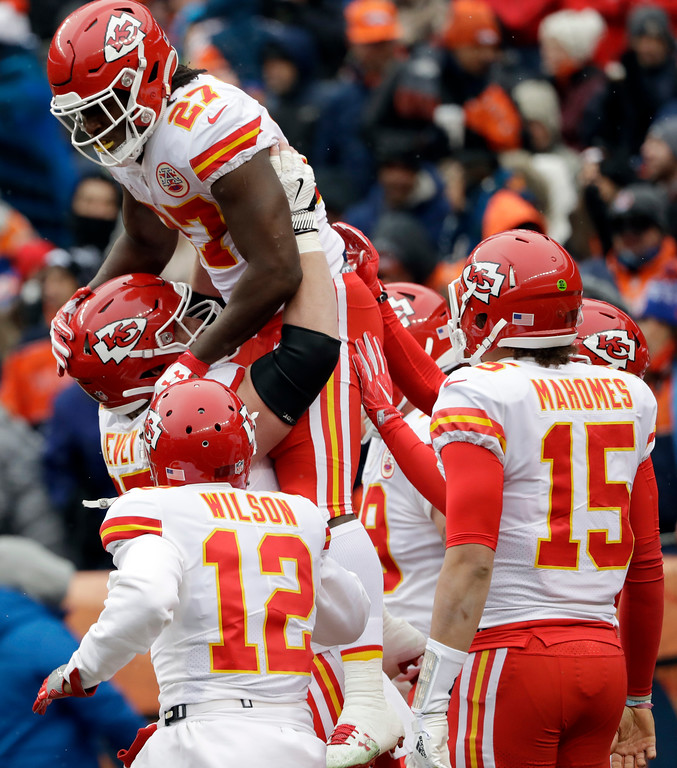 . Kansas City Chiefs running back Kareem Hunt (27), top, is lifted by teammates after a rushing touchdown against the Denver Broncos during the first half of an NFL football game, Sunday, Dec. 31, 2017, in Denver. (AP Photo/Joe Mahoney )