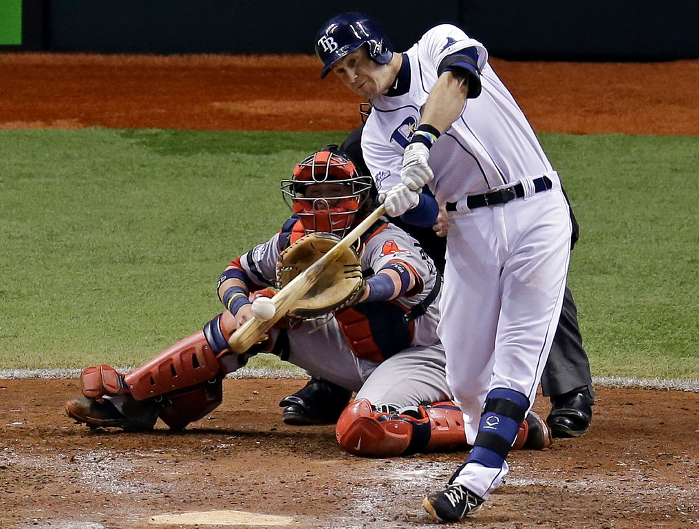 . Tampa Bay Rays third baseman Evan Longoria, right, hits a three-run home run as Boston Red Sox catcher Jarrod Saltalamacchia watches in the fifth inning during Game 3 of an American League baseball division series in St. Petersburg, Fla., Monday, Oct. 7, 2013. (AP Photo/John Raoux)