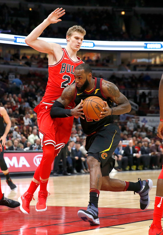 . Cleveland Cavaliers\' LeBron James, right, drives against Chicago Bulls\' Lauri Markkanen during the first half of an NBA basketball game Monday, Dec. 4, 2017, in Chicago. (AP Photo/Charles Rex Arbogast)