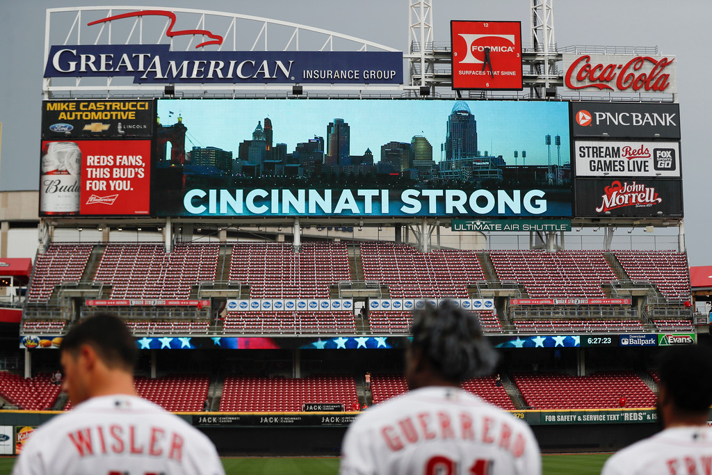 . A moment of silence is observed in respect for the three dead and others wounded in a shooting downtown at Great American Ball Park before a baseball game between the Cincinnati Reds and the San Diego Padres, Thursday, Sept. 6, 2018, in Cincinnati. (AP Photo/John Minchillo)