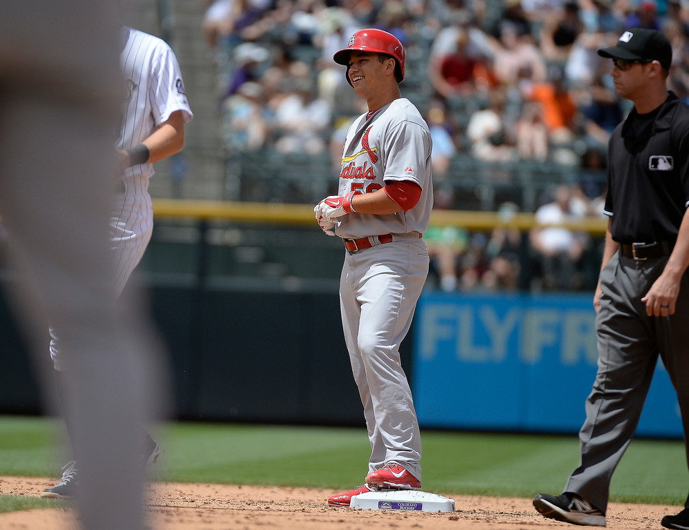 . St. Louis Cardinals starting pitcher Marco Gonzales (56) smiles as he stands on second base after his double to center field off of Colorado Rockies starting pitcher Yohan Flande (58) in the third inning June 25, 2014 at Coors Field. (Photo by John Leyba/The Denver Post)