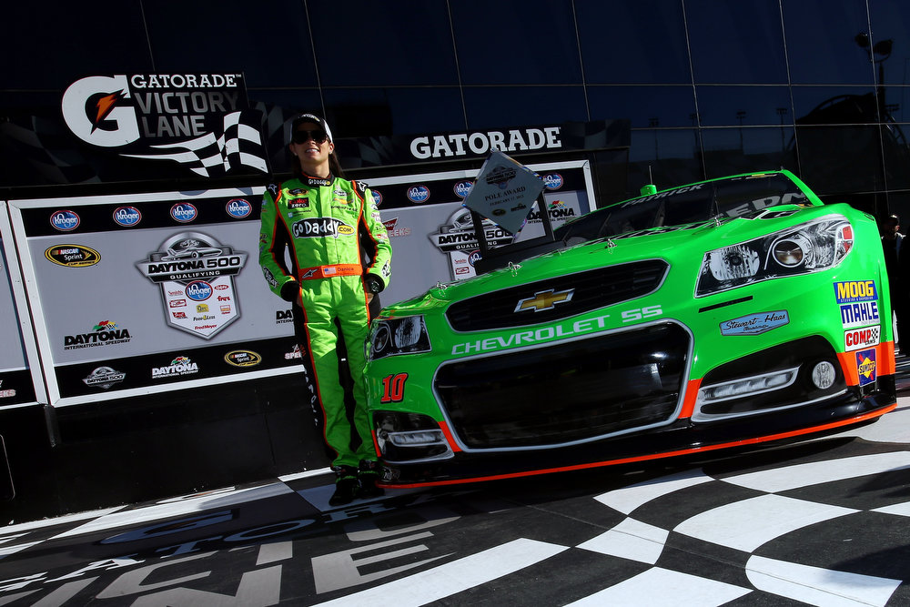 Description of . DAYTONA BEACH, FL - FEBRUARY 17:  Danica Patrick, driver of the #10 GoDaddy.com Chevrolet, poses after winning the pole award for the NASCAR Sprint Cup Series Daytona 500 at Daytona International Speedway on February 17, 2013 in Daytona Beach, Florida.  (Photo by Jonathan Ferrey/Getty Images)