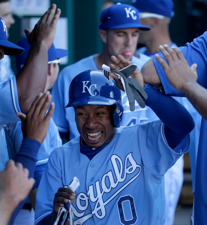 . Kansas City Royals\' Terrance Gore (0) celebrates in the dugout after scoring on a double by Alex Gordon during the seventh inning of a baseball game against the Detroit Tigers, Sunday, Sept. 21, 2014, in Kansas City, Mo. (AP Photo/Charlie Riedel)