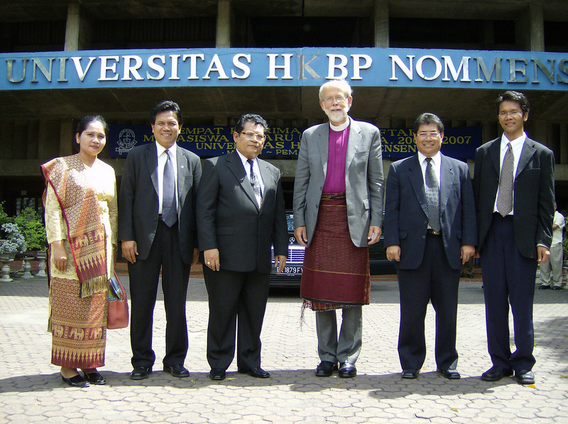 The Rev. Mark S. Hanson (3rd from right), ELCA presiding bishop and LWF  president, was welcomed July 1 with traditional garb by officials of the  HKBP's Nommensen University, Medan, Indonesia.