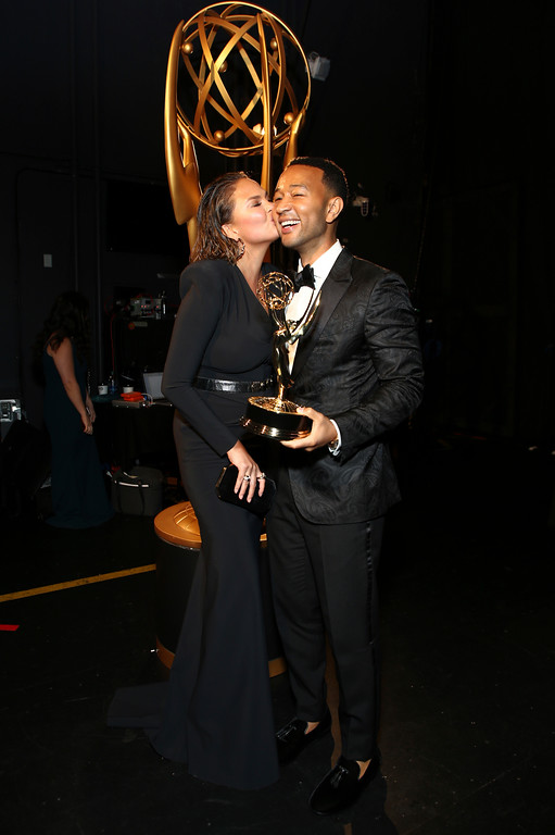 ". Chrissy Teigen, left, and John Legend pose with the award for outstanding variety special for ""Jesus Christ Superstar Live in Concert\"" during night two of the Television Academy\'s 2018 Creative Arts Emmy Awards at the Microsoft Theater on Sunday, Sept. 9, 2018, in Los Angeles. (Photo by John Salangsang/Invision/AP)"