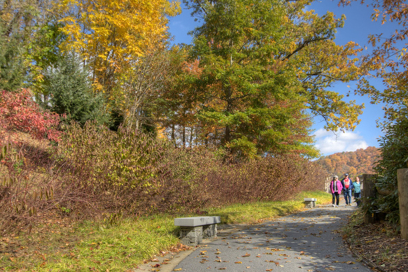 A family walks along the path leading to the scenic overlook at the North Carolina Welcome Center on Interstate 26 in Mars Hill, NC on Sunday, November 3, 2013. Copyright 2013 Jason Barnette