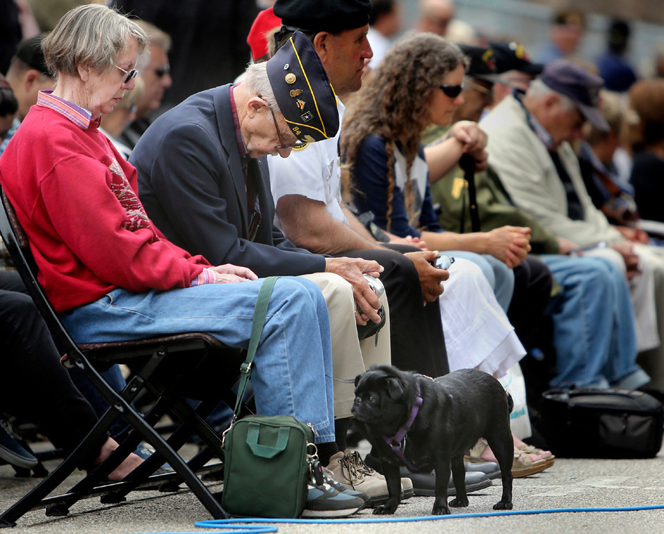 . Veterans, along with local service men, women and their families, lower their heads in prayer during the annual Memorial Day Remembrance ceremony at Evergreen Cemetery in Santa Cruz on Monday. (Kevin Johnson/Sentinel)