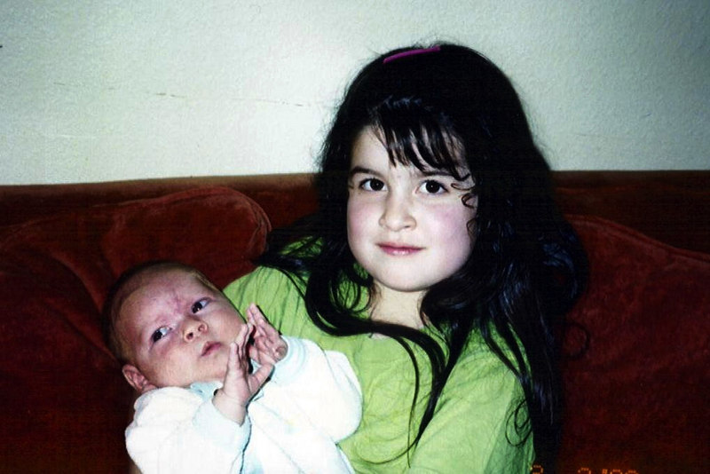 Davene the older sister with baby Kaily 2003