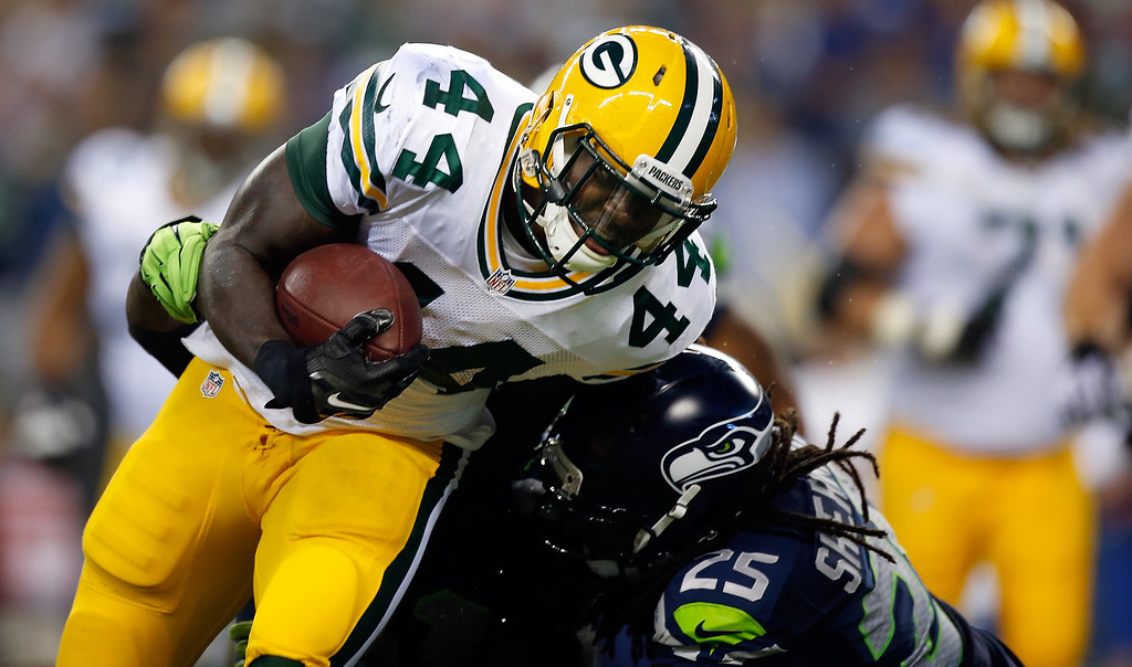 . SEATTLE, WA - SEPTEMBER 04: Running back James Starks #44 of the Green Bay Packers is hit by cornerback Richard Sherman #25 of the Seattle Seahawks during the third quarter of the game at CenturyLink Field on September 4, 2014 in Seattle, Washington.  (Photo by Otto Greule Jr/Getty Images)