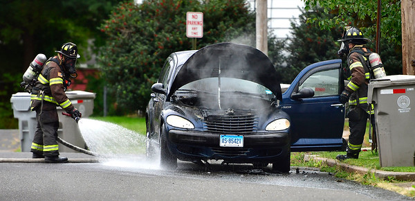 9/6/2019 Mike Orazzi   StaffrBristol firefighters extinguish a vehicle fire on George Street after it caught fire on Friday afternoon. No injuries were reported and the fire was put out quickly.
