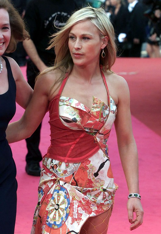 ". American actress Patricia  Arquette arrives at the Festival Palace to attend the screening of ""Va Savoir (Who Knows)\"" in Cannes, France, Wednesday, May 16, 2001.  The film, directed by Jacques Rivette, is in competition at the 54th Cannes Film Festival. (AP Photo/Laurent Rebours)"