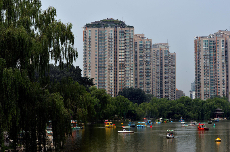 . A rooftop apartment surrounded by imitation rocks that is the subject of controversy after it was declared illegal in Beijing is pictured on August 13, 2013.  An eccentric Beijing resident has built a huge house among what looks like a pile of rocks dotted with trees on top of a 26-storey apartment block in the capital. Neighbours have complained about China\'s latest architectural oddity, which covers more than 1,000 square metres (10,000 square feet), saying they fear it could cause the structure to collapse on top of them.    MARK RALSTON/AFP/Getty Images