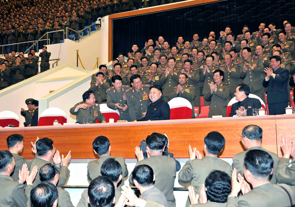 . Military officials applaud as North Korean leader Kim Jong-un smiles during the Unhasu concert in Pyongyang, in this picture released by North Korea\'s KCNA news agency on April 16, 2013.    REUTERS/KCNA