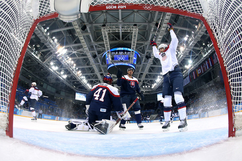 . John Carlson #4 of United States (L) scores a goal against Jaroslav Halak #41 of Slovakia in the first period during the Men\'s Ice Hockey Preliminary Round Group A game on day six of the Sochi 2014 Winter Olympics at Shayba Arena on February 13, 2014 in Sochi, Russia.  (Photo by Martin Rose/Getty Images)