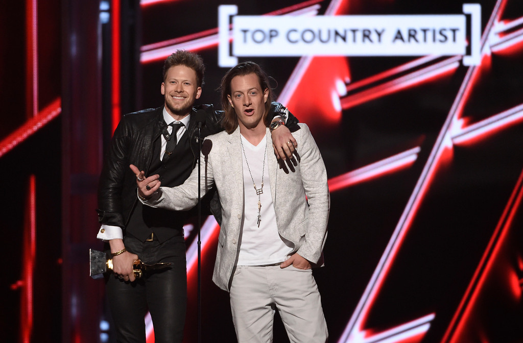 . Brian Kelley, left, and Tyler Hubbard of Florida Georgia Line accept the award for top country artist at the Billboard Music Awards at the MGM Grand Garden Arena on Sunday, May 17, 2015, in Las Vegas. (Photo by Chris Pizzello/Invision/AP)