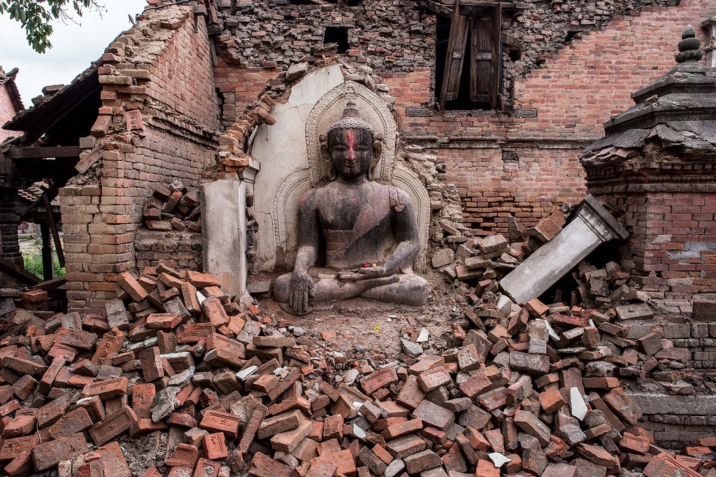 . A Buddha statue sits among the debris of a collapsed temple on April 29, 2015 in Bhaktapur, Nepal. A major 7.8 earthquake hit Kathmandu mid-day on Saturday, and was followed by multiple aftershocks that triggered avalanches on Mt. Everest that buried mountain climbers in their base camps. Many houses, buildings and temples in the capital were destroyed during the earthquake, leaving over 5000 dead and many more trapped under the debris, as emergency rescue workers attempt to clear debris and find survivors. Regular aftershocks have hampered recovery missions as locals, officials and aid workers attempt to recover bodies from the rubble.  (Photo by David Ramos/Getty Images)