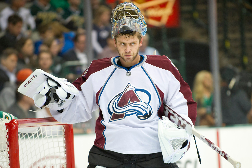 . DALLAS, TX - NOVEMBER 1:  Semyon Varlamov #1 of the Colorado Avalanche looks on during a timeout against the Dallas Stars on November 1, 2013 at the American Airlines Center in Dallas, Texas.  (Photo by Cooper Neill/Getty Images)