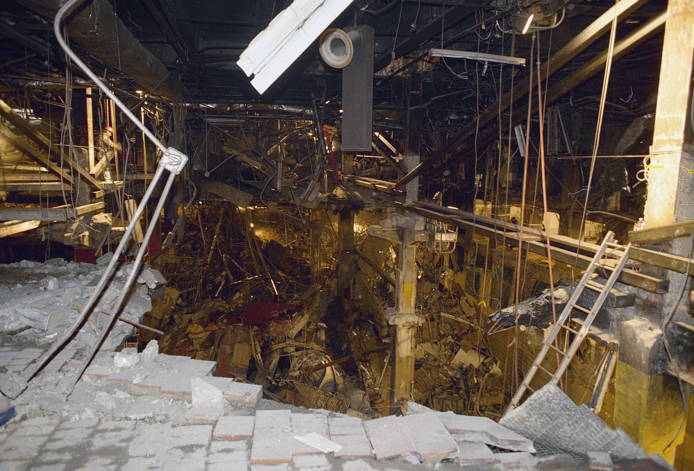 Description of . A gaping hole caused by an explosion in an underground garage at New York's World Trade Center reveals various levels of parking beneath the twin towers complex, March 8, 1993.  New steel beams were added over the weekend to help shore up the center's shaken foundation.  (AP Photo/Richard Drew)