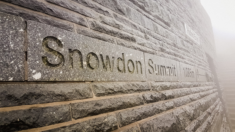 Mt Snowdon summit, 1,085 m! However the summit cafe here had just closed with all staff evacuated due to severity of the storm. The train had been stopped (seemingly for fear it might be blown off the mountain by what was then a raging gale). There were few guests, and no Jasmijn and party!