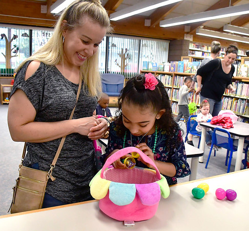 4/20/2019 Mike Orazzi | Staff Candice Rondeau and her daughter Gianna Sapp,7, during the Manross Library Egg Hunt in Forestville on Saturday.