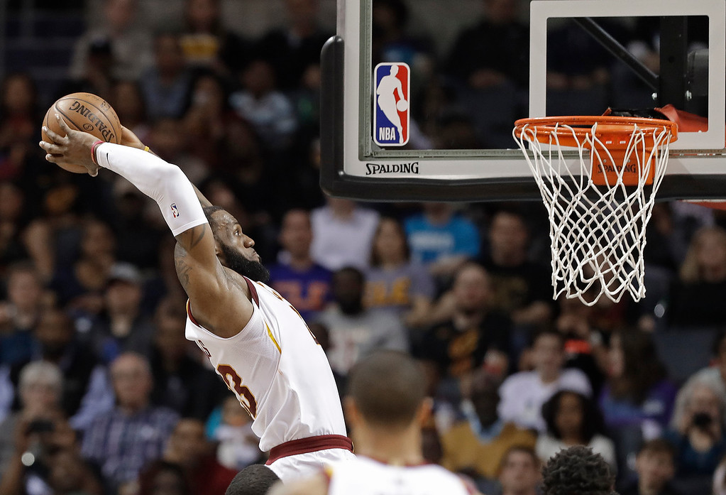 . Cleveland Cavaliers\' LeBron James goes up to dunk against the Charlotte Hornets during the first half of an NBA basketball game in Charlotte, N.C., Wednesday, March 28, 2018. (AP Photo/Chuck Burton)
