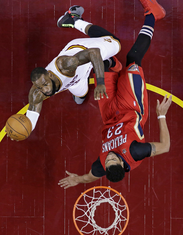 . Cleveland Cavaliers\' LeBron James, left, is called for an offensive foul against New Orleans Pelicans\' Anthony Davis in the first half of an NBA basketball game, Monday, Jan. 2, 2017, in Cleveland. (AP Photo/Tony Dejak)