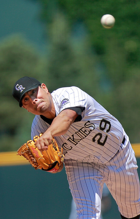 . Colorado Rockies starting pitcher Jorge De La Rosa throws to a San Diego Padres\' batter during the first inning of a baseball game Wednesday, Aug. 14, 2013, in Denver. The Rockies won 4-2. (AP Photo/Barry Gutierrez)