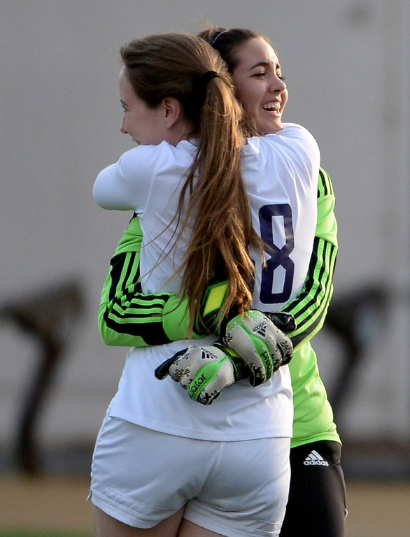 . Diamond Bar\'s Victoria Phinney (38) hugs goal keeper Stevie Eide after defeating Bishop Amat 3-2 during a CIF-SS second round prep playoff soccer match at Diamond Bar High School in Diamond Bar, Calif., on Wednesday, Feb.26, 2014. (Keith Birmingham Pasadena Star-News)