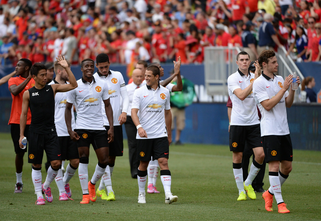 . Manchester United players are leaving field after the game against AS Roma in Guinness International Champions Cup 2014 at Sports Authority Field at Mile High in Denver, Colorado,  July 26, 2014. (Photo by Hyoung Chang/The Denver Post)