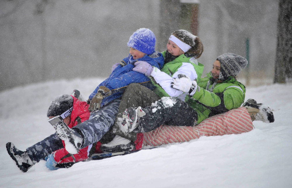 Description of . From left, Melanie Criswell,16, Lee Santee,12, Lauren Criswell,13, and Mathilda Santee, 13 sled at Berkley Hills golf course in Upper Yoder Township near Johnstown, Pa., Wednesday, Dec. 26, 2012. (AP Photo/Tribune-Democrat, John Rucosky). (AP Photo/The Tribune-Democrat, John Rucosky)