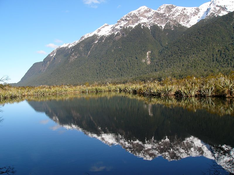 "Mountain reflection. One of the bus stops on the way from Queenstown to Milford Sound. The ""Lord of the Rings"" was filmed in New Zealand, mostly on the South Island around Queenstown, as far as I can gather. It is possible to go on ""Lord of the Rings"" horseback and boat rides to visit film set locations. The director, Peter Jackson, is now a New Zealand national hero."