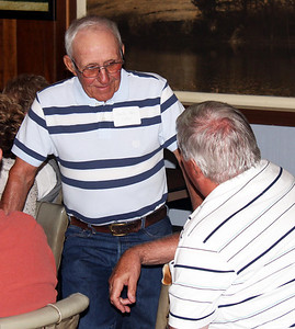 Charlie Littrel talks with Dennis Boggs.