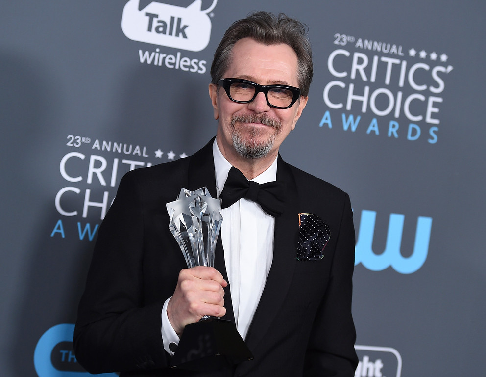 ". Gary Oldman poses in the press room with the award for best actor - film for ""The Darkest Hour\"" at the 23rd annual Critics\' Choice Awards at the Barker Hangar on Thursday, Jan. 11, 2018, in Santa Monica, Calif. (Photo by Jordan Strauss/Invision/AP)"