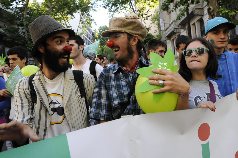 . Two men participate during the so called \'Last march of the illegal marijuana\' summoned by the groups that have long stood for the legalization of marijuana in the streets of Montevideo, Uruguay, 10 December 2013. The march goes up to the Legislative Palace where the Senate is discussing the law that legalizes the production and sale of marijuana in Uruguay that will face final approval today.  EPA/Sandro Pereyra